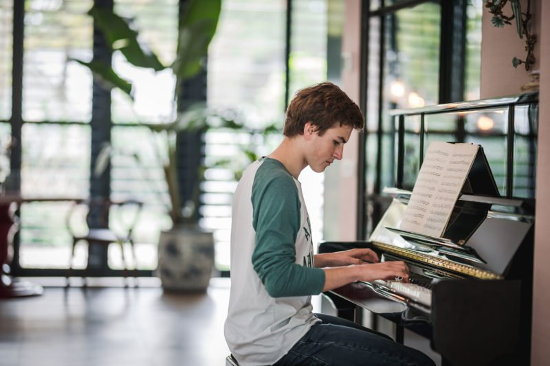 stock dutch interior design young boy playing piano