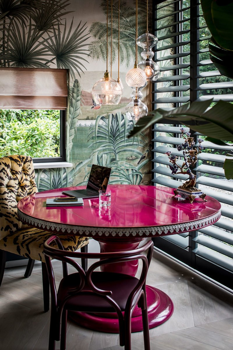 dutch interior design pink table palm wallpaper tiger chair