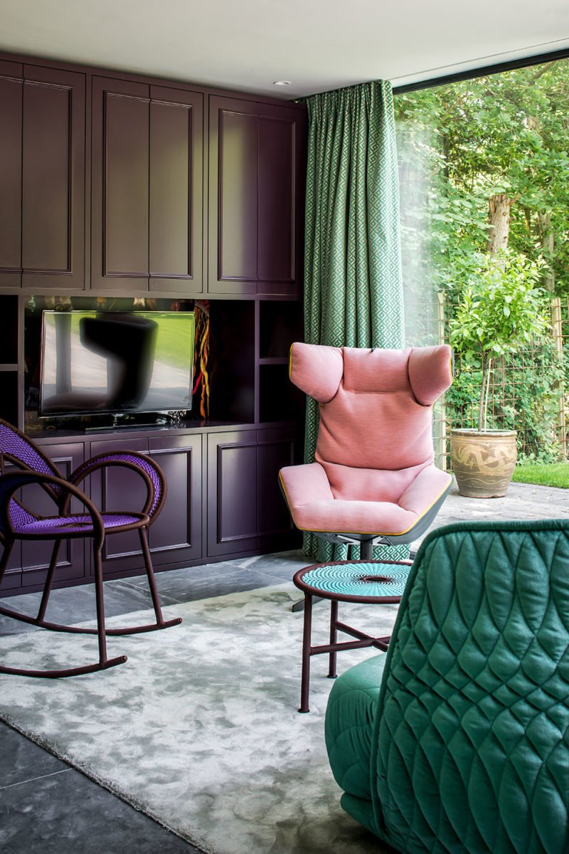 dutch interior design pink chair cyan sofa