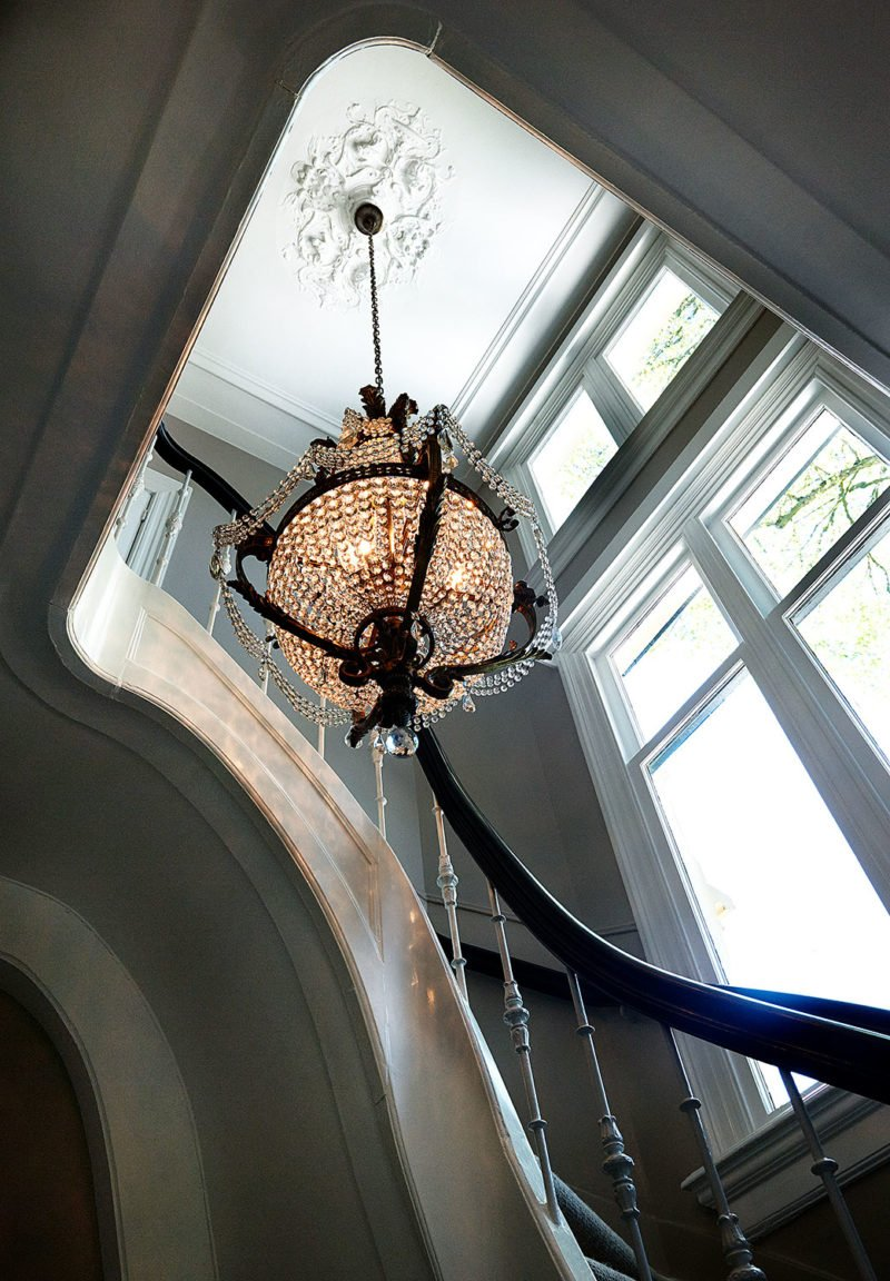 dutch interior design chandelier hallway stairs