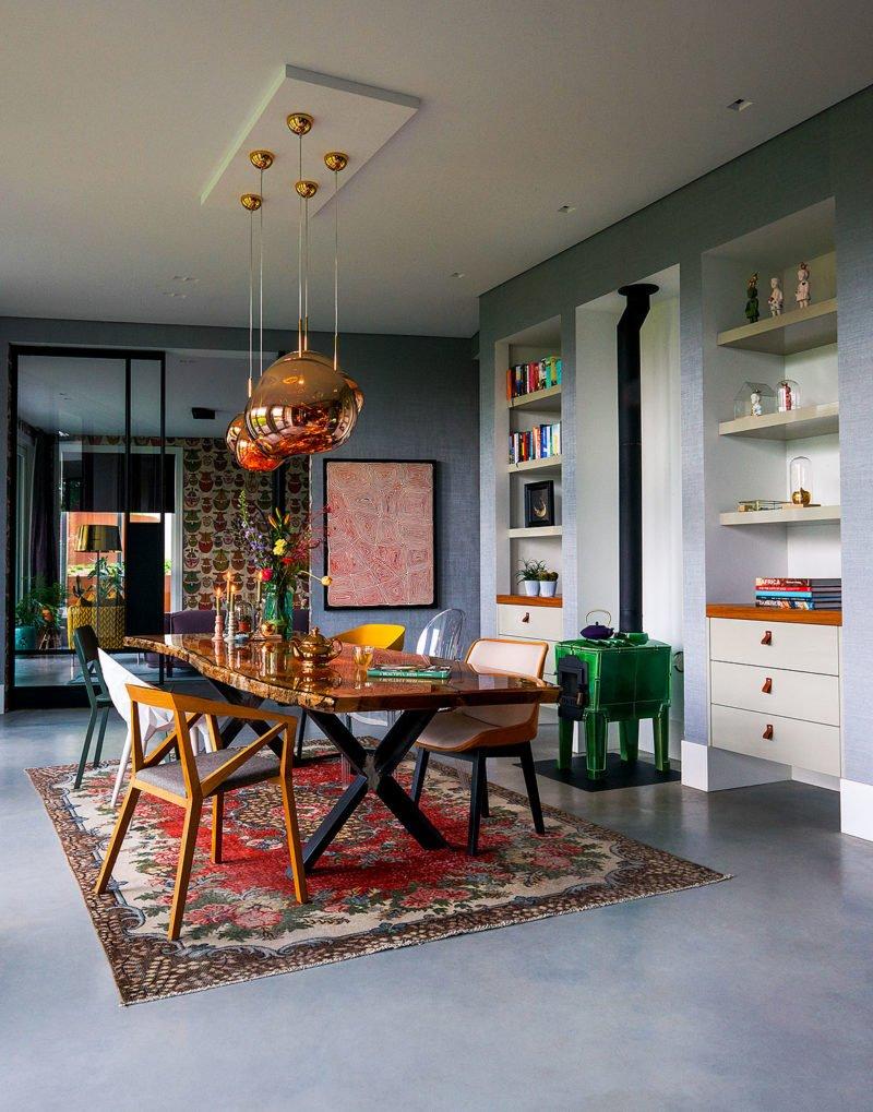 dutch interior design gold lamp wooden table