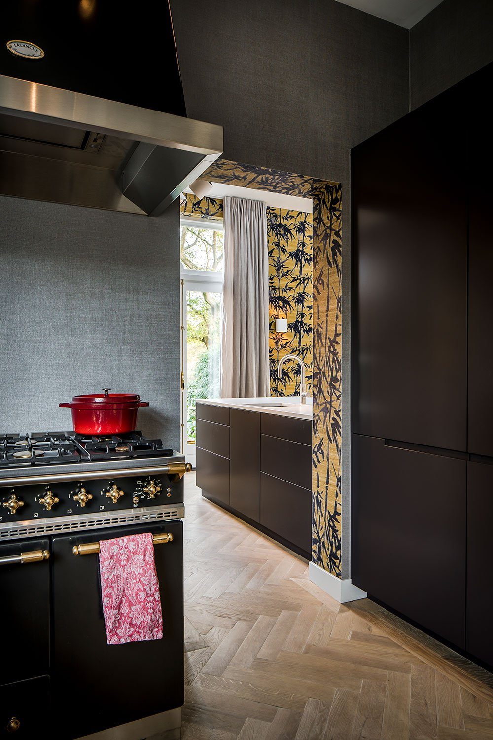 dutch interior design stove dark kitchen gold details