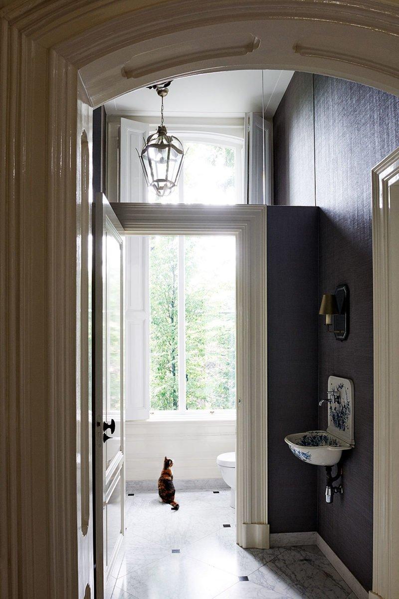 dutch interior design cat window hallway old lamp