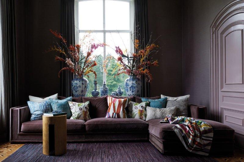 stock dutch interior design purple sofa pillows