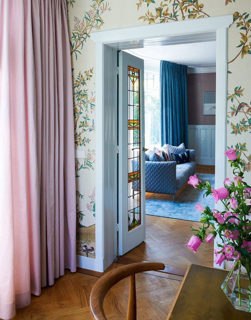colorful living room with pink roses and curtains
